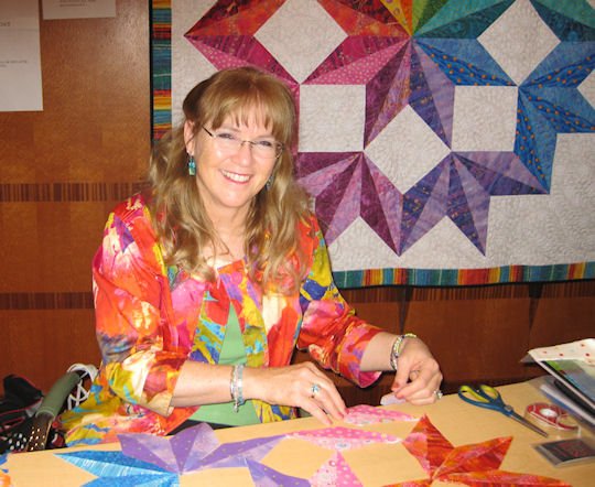 Jan with a Rainbow Split Broken Star quilt