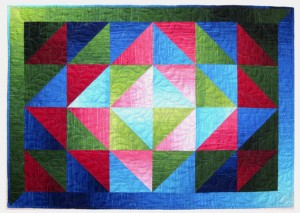 Glowing Jewels quilt by Jan Krentz