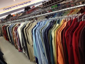 colorful shirts arranged by hue